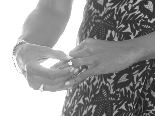 Woman Putting On Engagement Ring