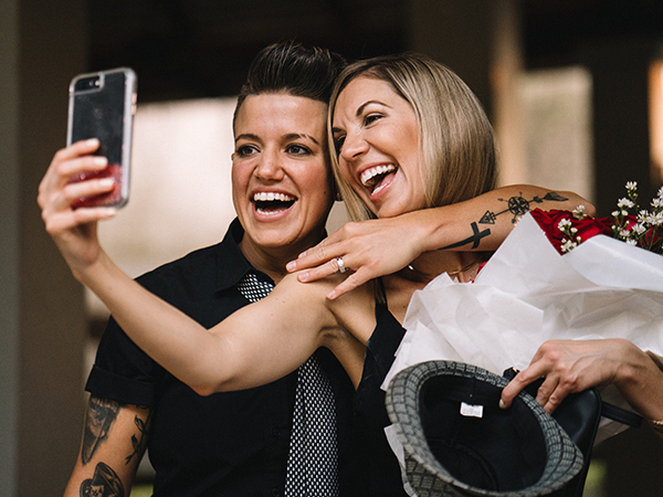 Karrie and Casey take a cellphone selfie with Casey's engagement ring.