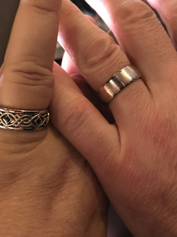 Close-up of David and Lea's wedding rings.