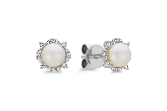 Pearl and diamond stud earrings.
