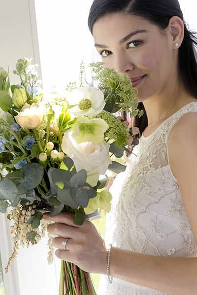 Bride holding a bouquet of flowers.