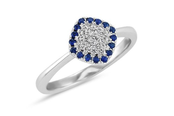 Triangle shaped blue sapphire and diamond cluster engagement ring.