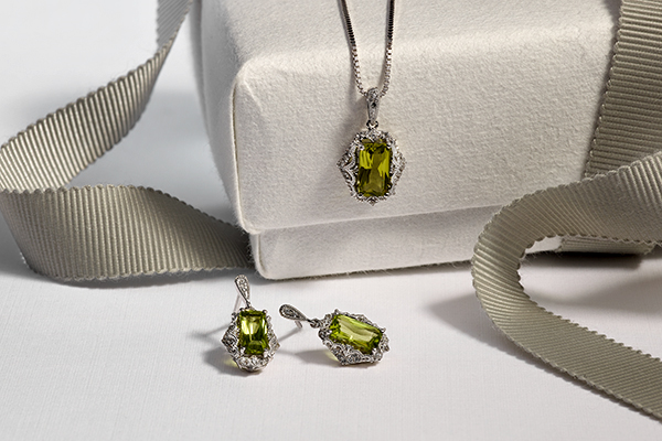 Emerald shaped Peridot and Diamond necklace and matching earrings.