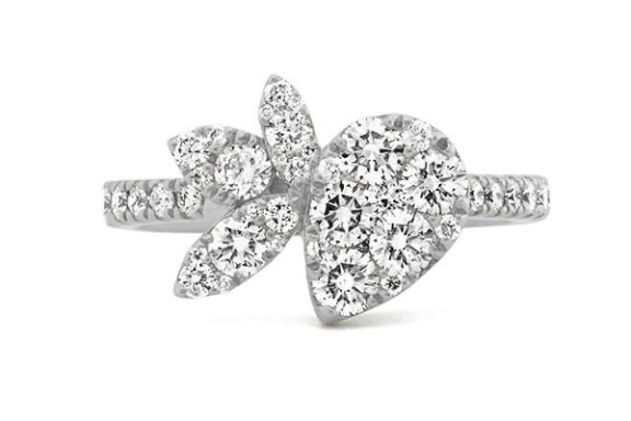 Floral style white gold diamond cluster engagement ring.