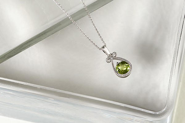 Peridot pendant necklace close-up.
