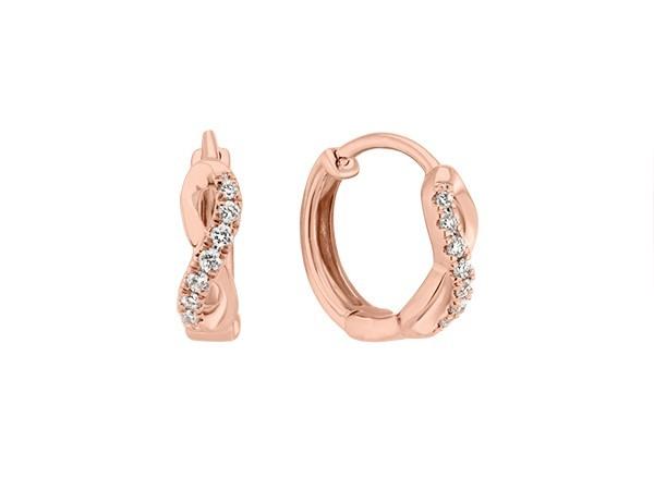 Rose gold diamond huggie earrings.