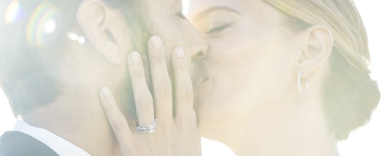 Married couple kissing.
