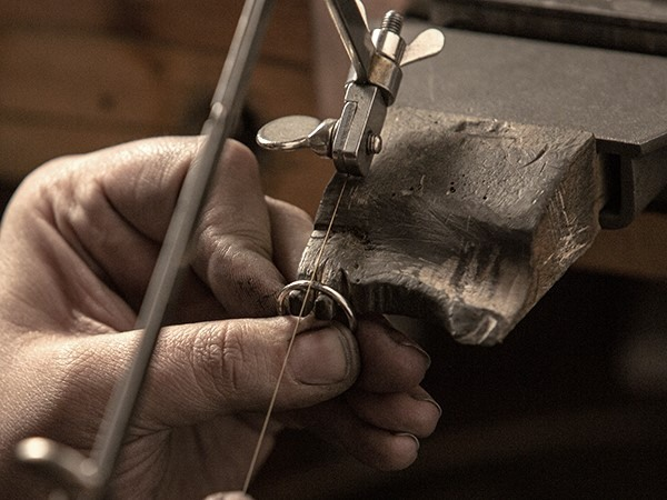 Jeweler resizing a ring.