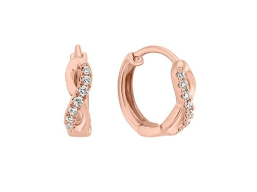 Rose gold diamond huggie hoop earrings.