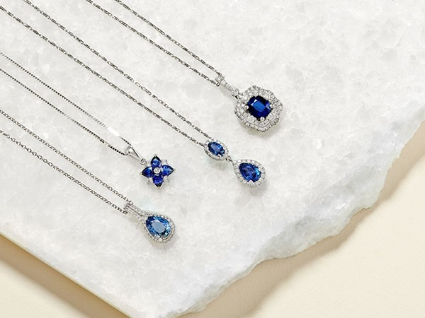 Collection of sapphire and diamond necklaces.