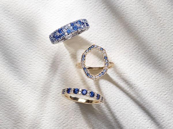 Three sapphire and diamond rings.