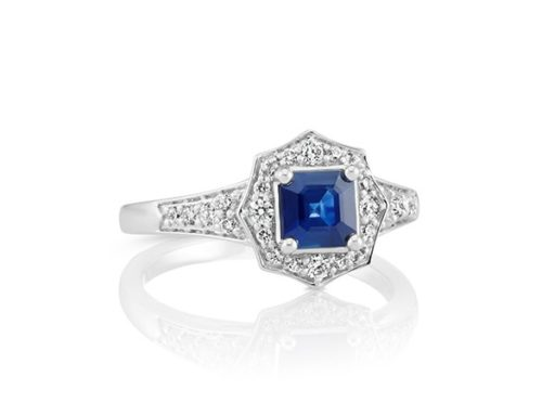 Sapphire center stone and diamond engagement ring.