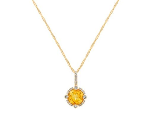 Round citrine and diamond pendant.