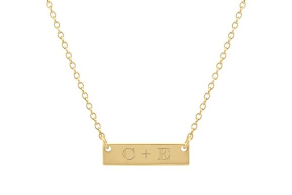 Engraved gold bar necklace.