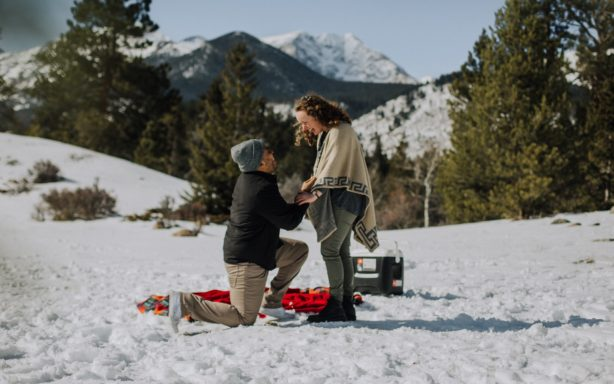 Man proposing to his girlfriend in the snow.