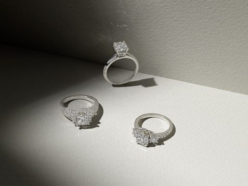 Three white gold engagement rings.
