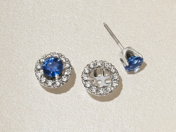 Diamond earring jackets on sapphire stud earrings.