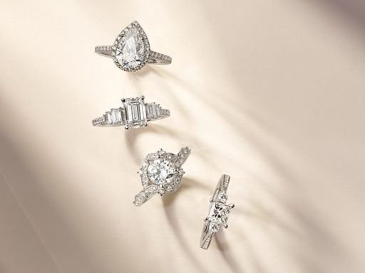 Four engagement rings with different styles.