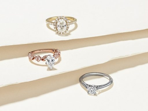 Three engagement rings varying in price.