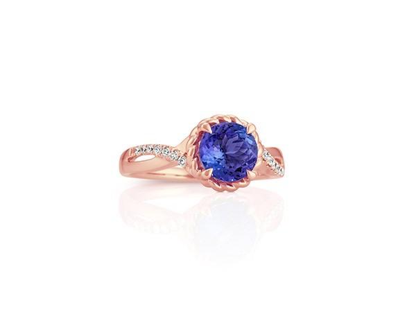 Round tanzanite and diamond swirl ring