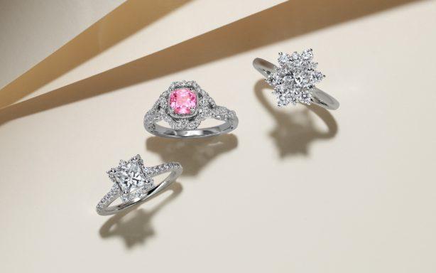 Three halo engagement rings.