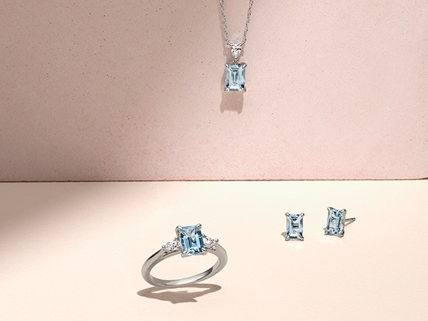Matching aquamarine necklace, earrings and cocktail ring.