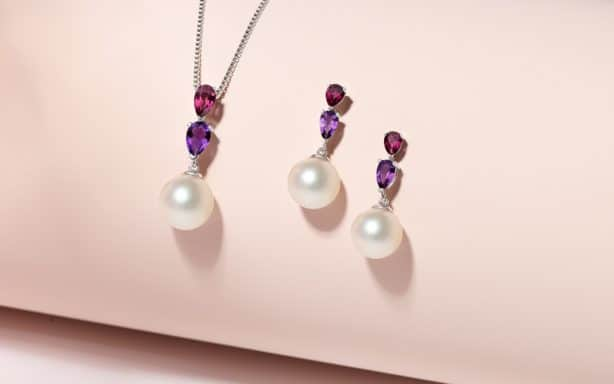 Pearl, amethyst and garnet pendant and earrings.