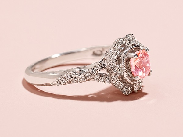 Pink sapphire halo engagement ring.
