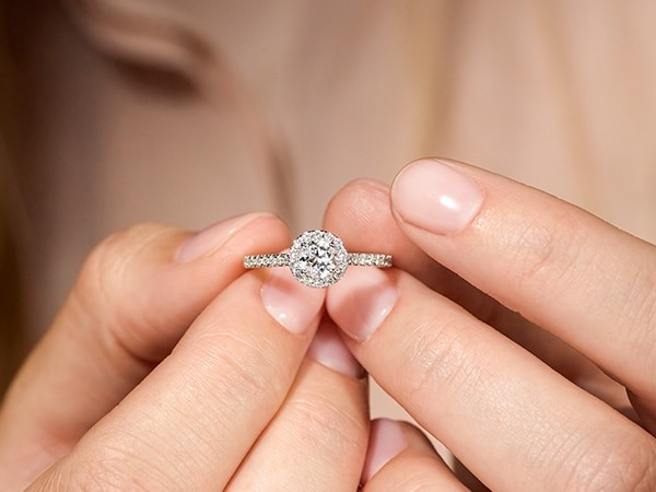 Woman holding an engagement ring.