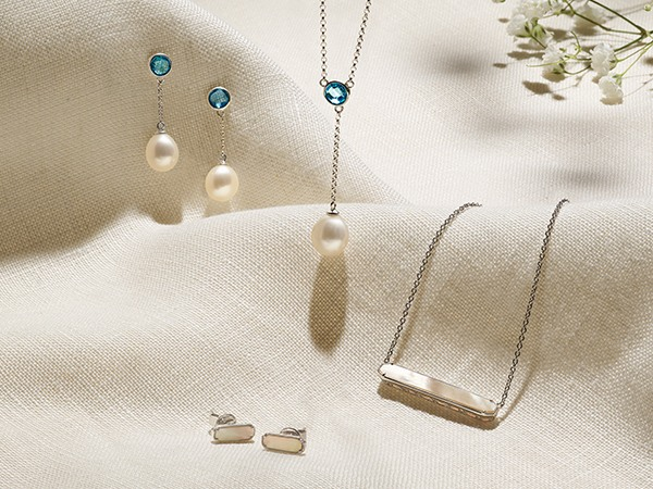 Pearl earrings and necklace with mother-of-pearl earrings and necklace.