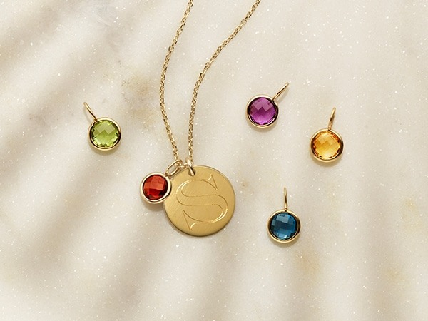 Gemstone harms and 14k gold pendant necklace.