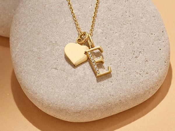 Initial charm with engravable 14k gold heart.