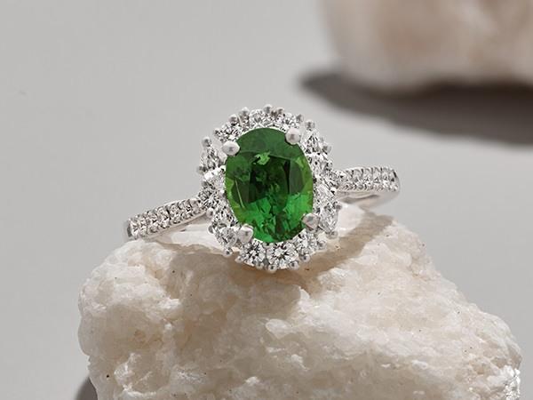 Green sapphire diamond halo engagement ring.